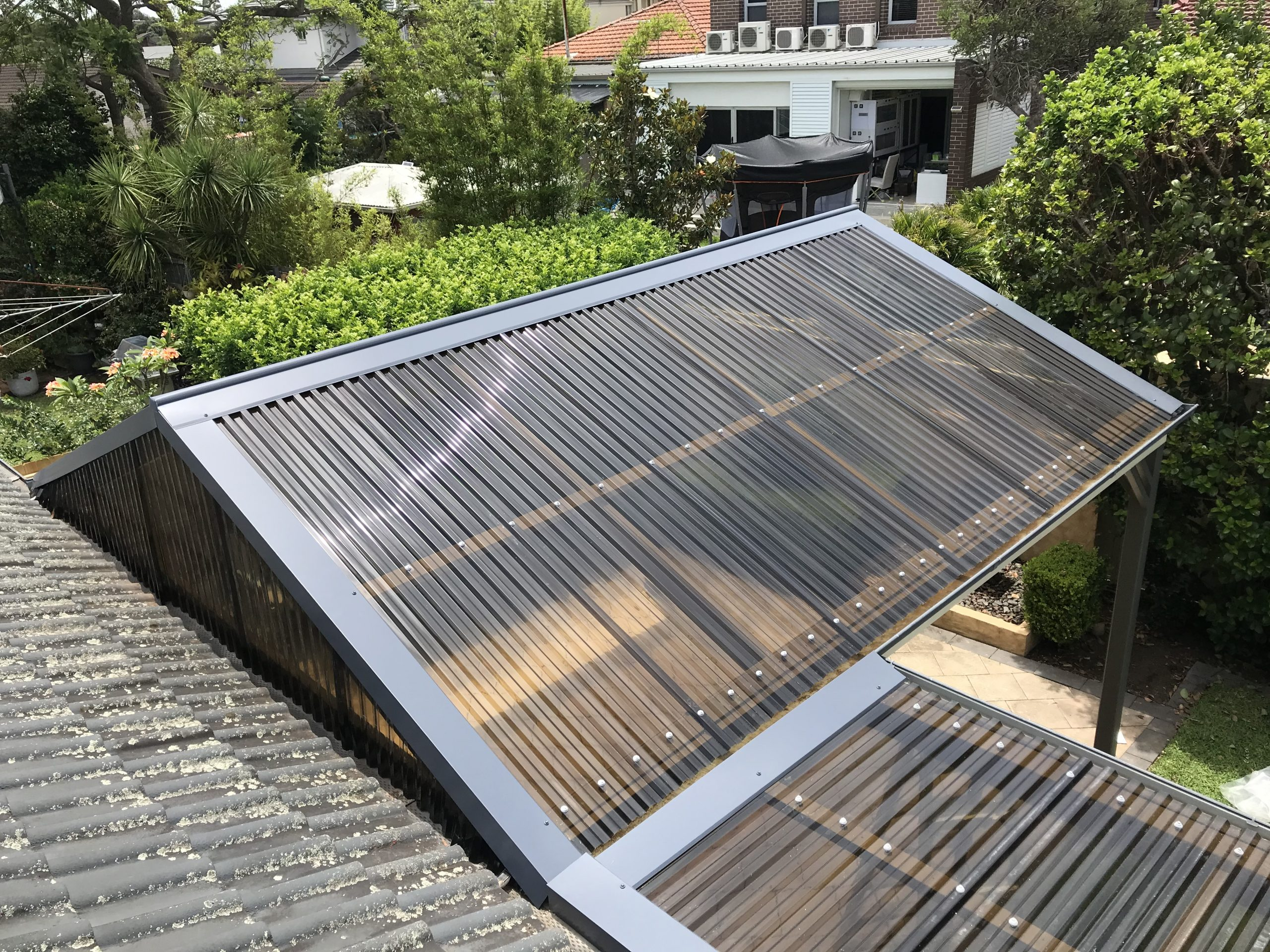 Polycarbonate roof and flashings