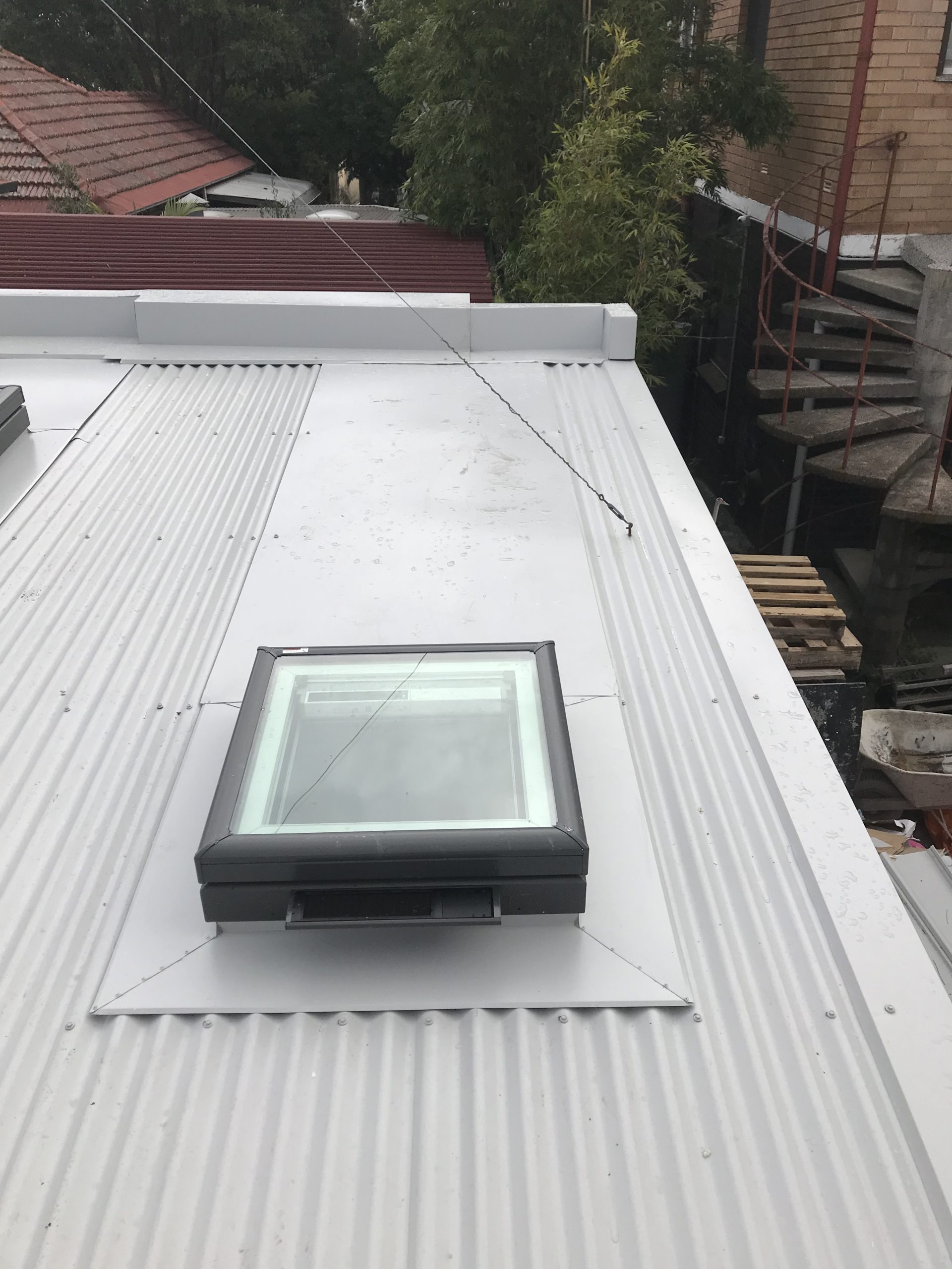 Roof and flashings and skylights